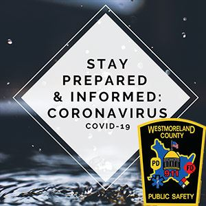 Sign stating Stay Informed and Prepared alongside Westmoreland County Dept of Public Safety Badge